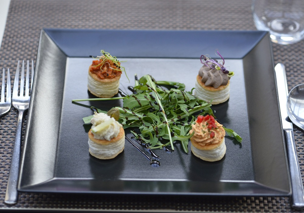 Burchée bites filled with a selection of traditional creams, served with rocket salad