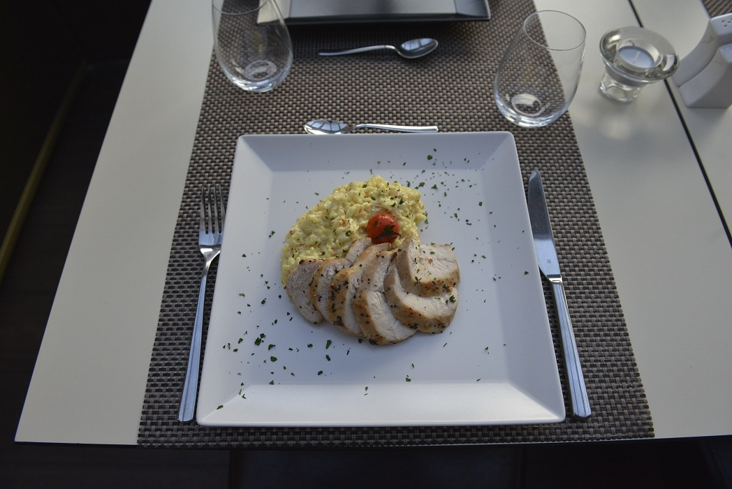 Chicken breast slices with saffron risotto